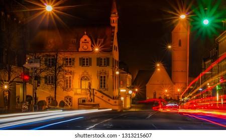 Citylights in downtown Fürstenfeldbruck with church and tower. Bayern bavaria