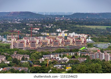 Cityscape of Aachen and surrounding landscape taken from above as background with university clinic in center