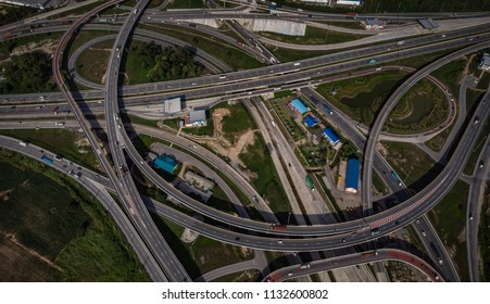 cityscape aerial top view from drone the industry ring road and motorway highways expressway freeway evening time