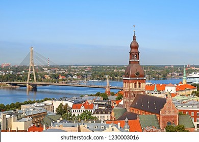 Cityscape aerial view on the old town with Dome cathedral and Vansu bridge through Daugava river in Riga city, Latvia
