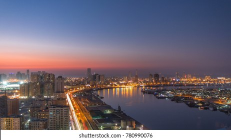 Cityscape of Ajman from rooftop from day to nigh transition timelapse with lake. Ajman is the capital of the emirate of Ajman in the United Arab Emirates. 4K