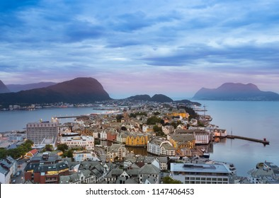 Cityscape of Alesund from the Byrampen viewpoint at night in summer, Norway.