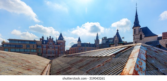 cityscape of Antwerp, Belgium, seen over the roofs of parking lots at the river Schelde