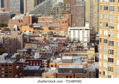 Cityscape of apartment and office buildings in Hell's Kitchen, New York City. Diverse architectural styles among tall skyscrapers.