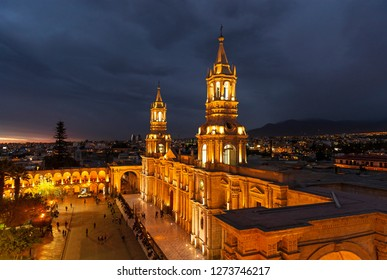 Cityscape of Arequipa after sunset with the illuminated Cathedral and the Plaza de Armas main square, Peru.