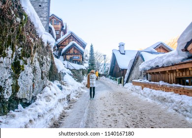 Cityscape around the Hallstatt Town. Beautiful view of traditional wooden houses in famous Hallstatt lakeside town in Alps on beautiful day in winter with snow, Salzkammergut region, Austria. Feb 2018