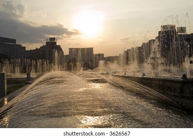 Cityscape with artesian wells in back-light