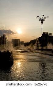 Cityscape with artesian wells in back-light, Bucharest, Romania