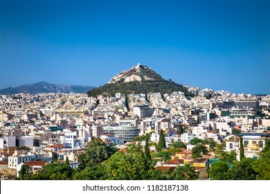 Cityscape of Athens and Lycabettus Hill also known as Lykabettos Lycabettos or Lykavittos. It is a Cretaceous limestone hill in Athens Greece.