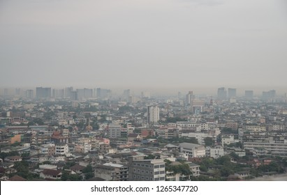 Cityscape of Bangkok the capital cities of Thailand covered by bad air pollution it is unhealthy. Pollution is a mixture of dust, dirt, soot and smoke.