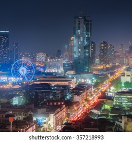 "Cityscape of Bangkok city at night. You will see the lively of Charoen Krung Road and the ferris wheel of ""ASIATIQUE The Riverfront,â?� the famous shopping mall on the banks of the Chao Phraya River."