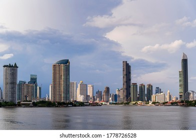 cityscape of Bangkok city skyline with river and blue sky background, Bangkok city is modern metropolis of Thailand and favorite of tourists