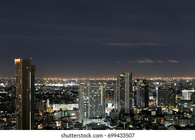Cityscape of Bangkok night with fluffy clouds