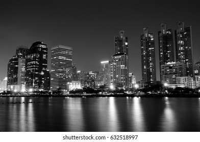 Cityscape of Bangkok at Night with Reflections of Lights (in monochrome)