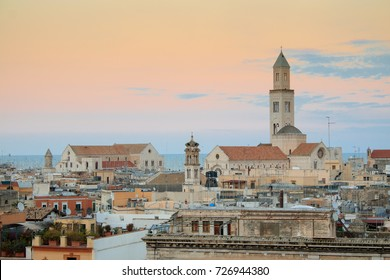 Cityscape of Bari at sunset with Basilica of San Nicola and Romanesque Cathedral. Bari, Italy, Europe
