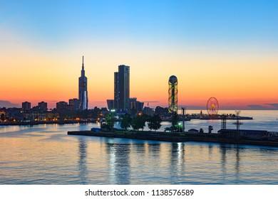 Cityscape of Batumi, Georgia, Black Sea resort city in red summer sunset light