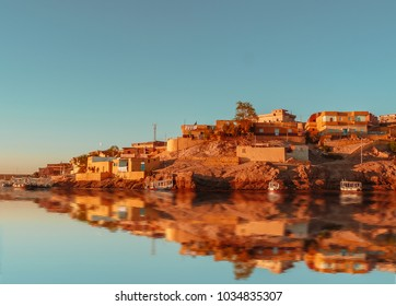 Cityscape for the beautiful Nubian city Aswan in Egypt at the golden hour of the sunset time.