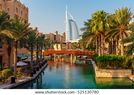 Cityscape with beautiful park with palm trees in Dubai, UAE