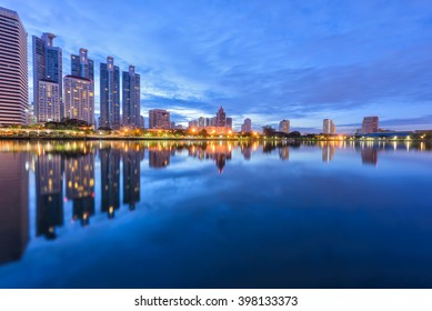 Cityscape of Benjakitti park Bangkok downtown city at night twilight evening, Bangkok Thailand