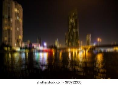 cityscape blurred image of the city bangkok at night