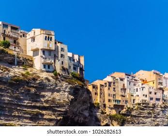 Cityscape of Bonifacio, Corsica, France. Residential area with apartment blocks built along the ridge of the Bonifacio cliffs.