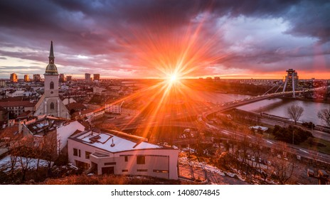 Cityscape of Bratislava, Slovakia with St. Martin's Cathedral and Danube River with New Bridge at Sunrise