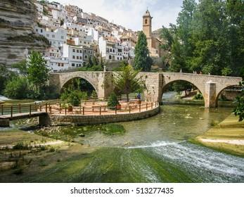 Cityscape with bridge over river at Alcala del Jucar in Castilla la Mancha, Spain