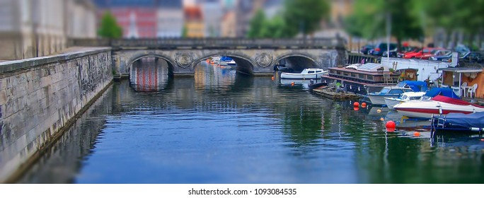 Cityscape with canal in Copenhagen, Denmark. Tilt–shift effect applied
