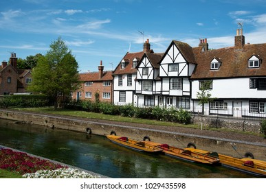 Cityscape of Canterbury, Kent UK and canal of river Stour passing through houses and colorful garden