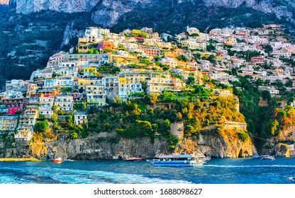 Cityscape and coastal landscape at Italian Positano luxury town on Amalfi Coast and Tyrrhenian Sea in Italy in summer. View of Amalfitana coastline. Vacation and holiday near Salerno.