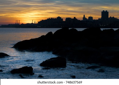 Cityscape coastal sunset scene at Montevideo city, Uruguay