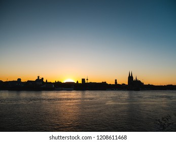 Cityscape of Cologne, Germany, at sunset. Cologne Cathedral, old town and river Rhine.