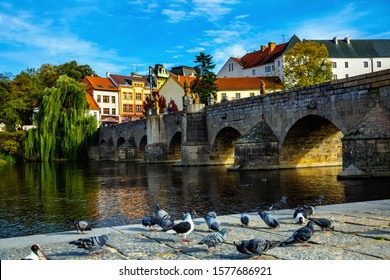 Cityscape of Czech town Pisek with stone bridge and old city - Shutterstock ID 1577686921