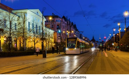 Cityscape of Debrecen streets in night lights with motion blur, Hungary