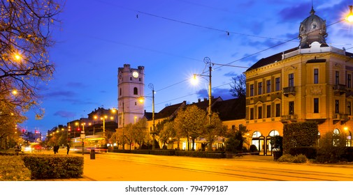 Cityscape of Debrecen streets with Small Reformed Church in night lights, Hungary
