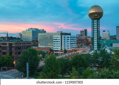 Cityscape of downtown Knoxville, Tennessee with Sunsphere at Worlds Fair Park at sunset.