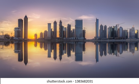 Cityscape of Dubai and panoramic view of Business bay with reflection of skyscrapers on water in the morning, UAE.