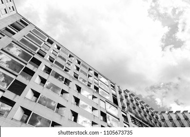 Cityscape facade detail in infrared black and white, on a cloudy day