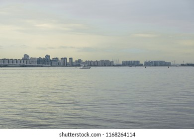 cityscape with a floating sea ship