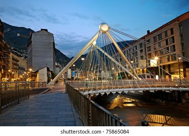 Cityscape of footbridge and buildings at night. Andorra.