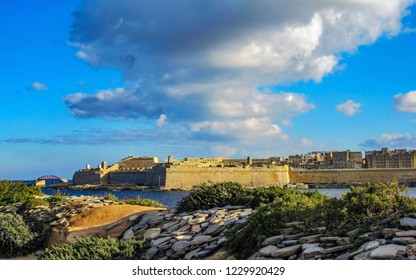 Cityscape with fortifications of Mediterranean island of Malta in sunny day with blue sky, Europe