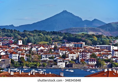 Cityscape of French border town Hendaye, as seen from Spanish Hondarribia, with Famous Rhune Mount at Background, Basque country, Province of Labourd, Atlantic Pyrenees, Aquitaine, France
