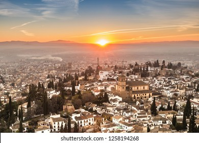 cityscape of granada by sunset