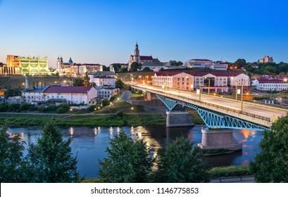 Cityscape of Grodno at dusk with bridge over Neman river, Belarus