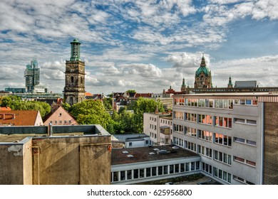 Cityscape of Hanover (Germany), including the modern building of a bank, the church Aegidienkirche and the town hall, HDR-technique