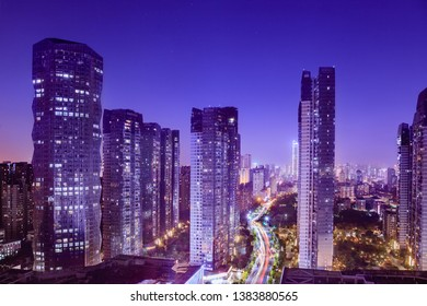 Cityscape with hectic traffic and skyscrapers at dusk,view in the business district.Fuzhou,Fujian,China