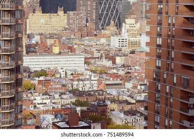 Cityscape of Hell's Kitchen in New York City, showing the skyscrapers and diverse architecture of Manhattan