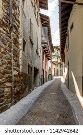 cityscape of historical village  with narrow cobbled street, shot in bright summer light at Gromo, Bergamo, Lombardy, Italy
