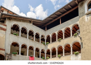 cityscape of historical village with old building arched loggias on stone mullions, shot in bright summer light at Gromo, Bergamo, Lombardy, Italy