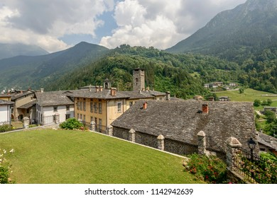 cityscape of historical village with old houses covered by slate roofs , shot in bright summer light at Gromo, Bergamo, Lombardy, Italy